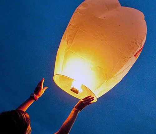 4/26/2010 -- Tuscaloosa, Ala. -- points at lanterns that were released at the Sky Lantern Festival